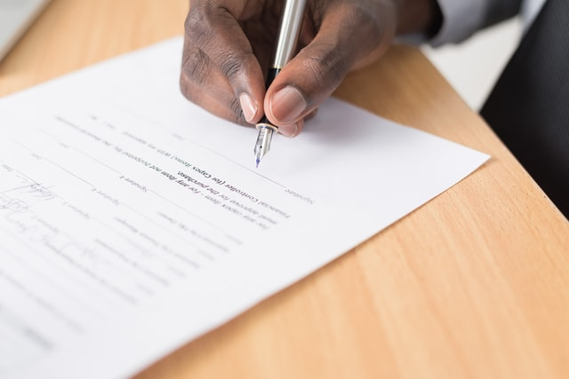 Hand signing a will