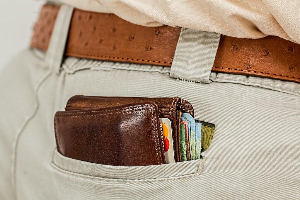 Wallet in man's back pocket