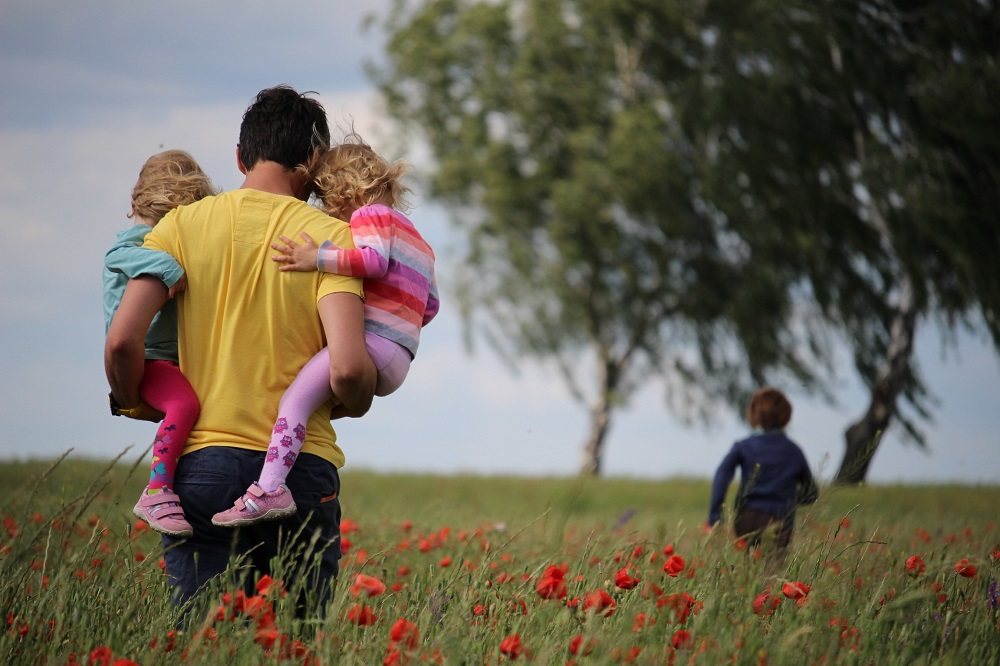 Main with children in field