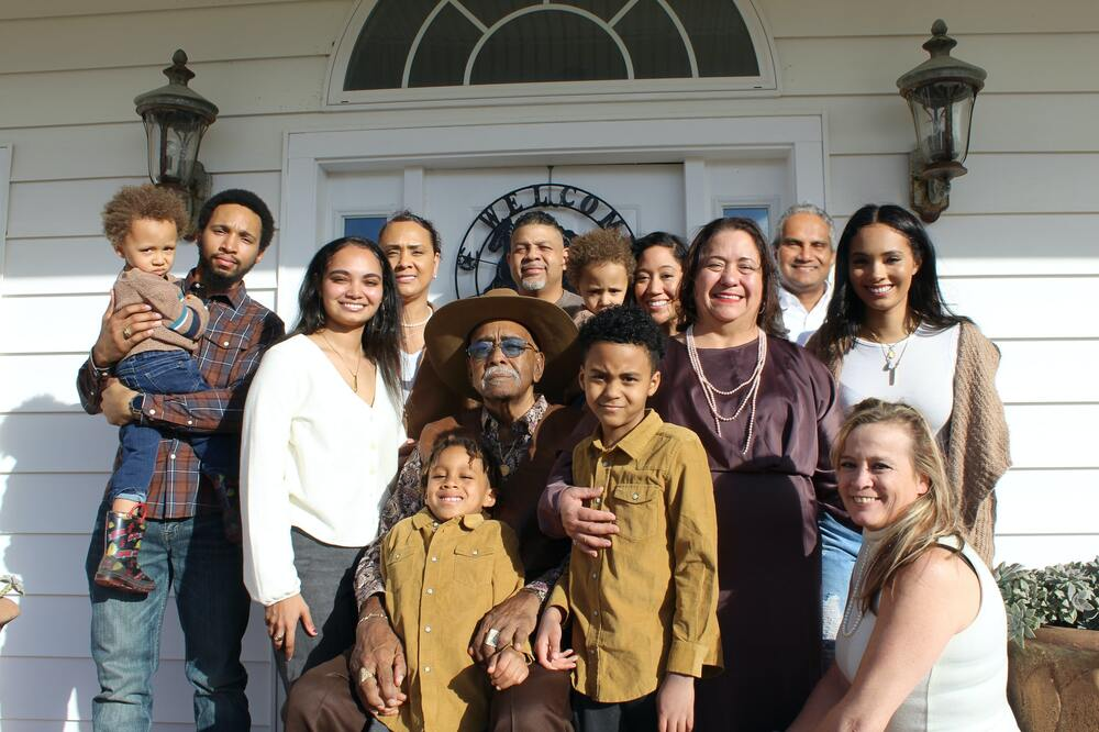 Large extended family in front of front porch