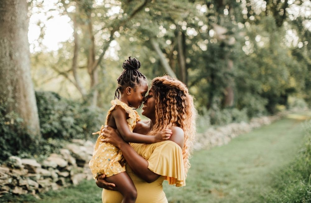 Woman and child hugging in forest