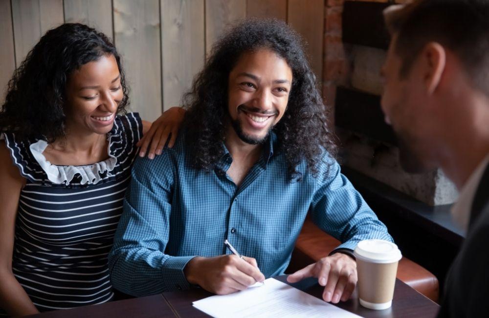 Happy man signing document